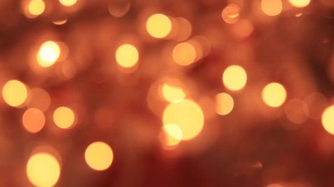 Abstract Blurred Christmas Lights Bokeh Background. 4K DCi SLOW MOTION 120 fps. Blinking Christmas Tree Lights Twinkling. Winter Holidays Concept. DOLLY SHOT
