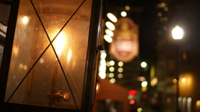 Christmas tree and fireplace scene through frozen window handheld shot of lantern outside store window in urban downtown city at night 4k stock mozeypictures Gallery