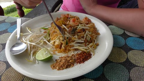 Woman Eating Pad Thai. Thai Style Noodles