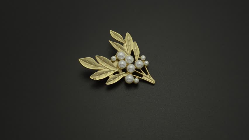 Golden brooch twig with pearls isolated on black   Shutterstock HD Video #33613450
