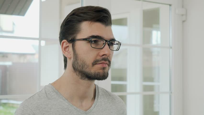 Portrait of bearded guy in eyeglasses | Shutterstock HD Video #33627721