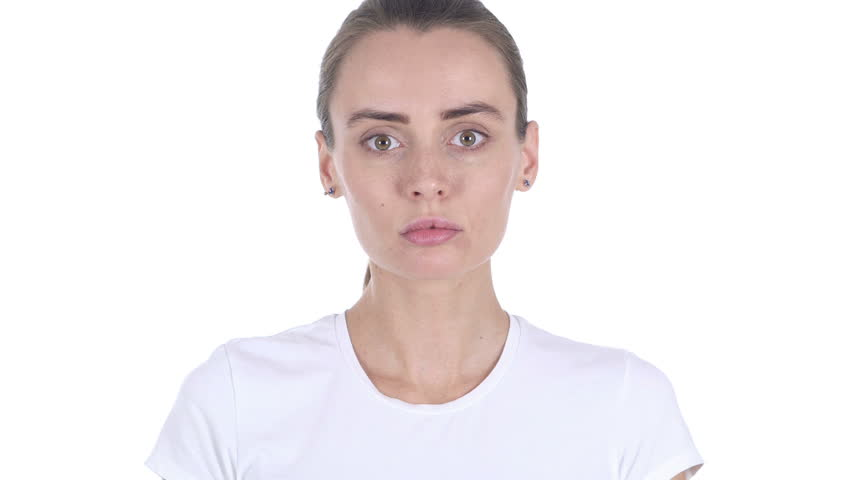 Serious Woman Looking at Camera in Studio on White Background | Shutterstock HD Video #33649621