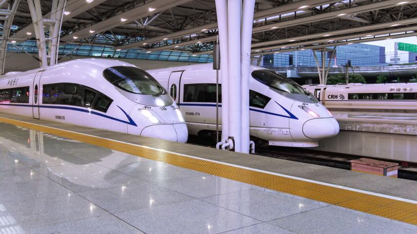 SHANGHAI, CHINA - CIRCA FEB, 2017: A Chinese Bullet Train leaves Hong-qiao Station in Shanghai, China.