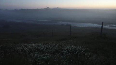 Scenic Icelandic morning landscape with mystical haze. 4K Footage.