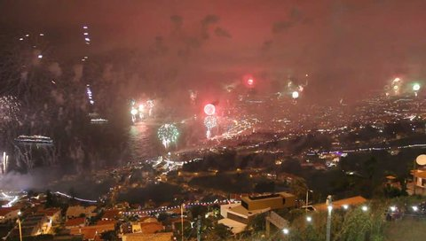 FUNCHAL, PORTUGAL - January 1, 2017: View of fireworks of new year over Funchal City, Madeira island, Portugal.