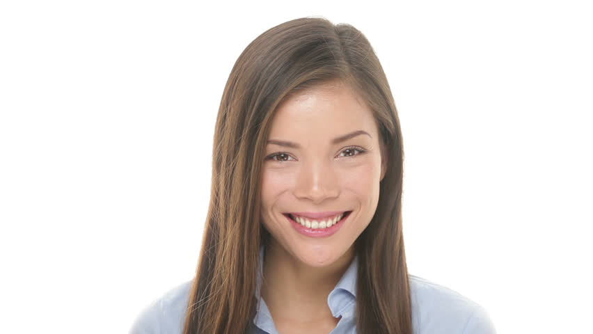 Woman smiling closeup portrait. Young business woman professional looking at camera happy. Beautiful multiethnic Asian / Caucasian female model on white background in studio. | Shutterstock HD Video #3374021