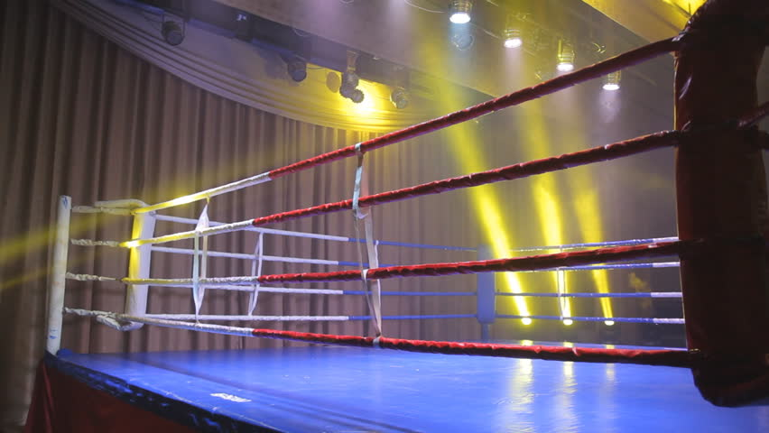 Boxing ring in lights of projectors