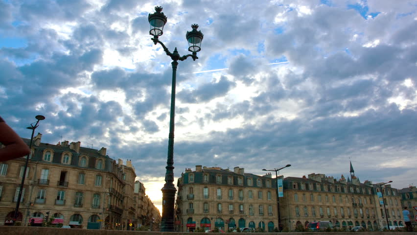 Sunset and lamppost on the quays of Bordeaux, France, timelapse.