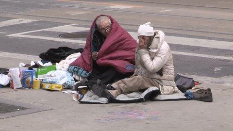 Toronto, Ontario, Canada December 2017 Desperate poor homeless couple living on the streets of Toronto