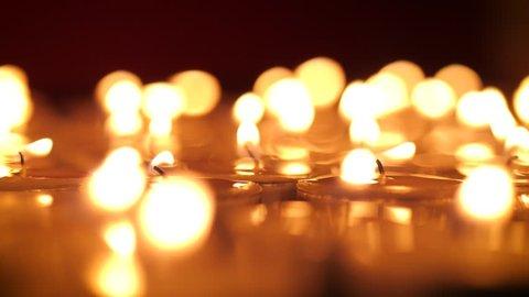 Tealight candles burning macro 4K