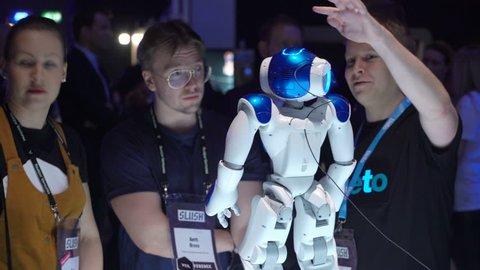 HELSINKI, FINLAND - NOVEMBER 30, 2017: Talking robot Nao autonomous, programmable humanoid robot by Aldebaran Robotics. Startup and tech event Slush in Messukeskus Expo center. Non-profit event for