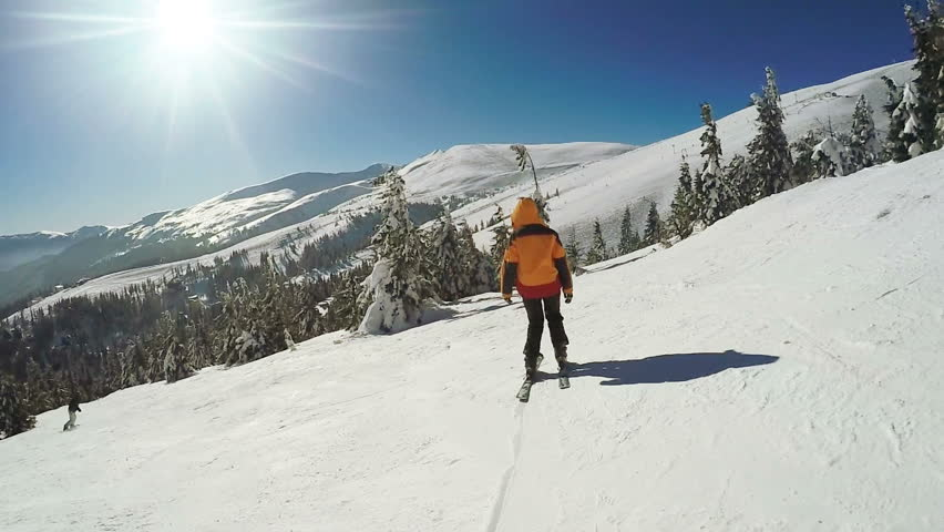 Dynamic Steadicam accompanies the descent from the mountain on skis | Shutterstock HD Video #33866611