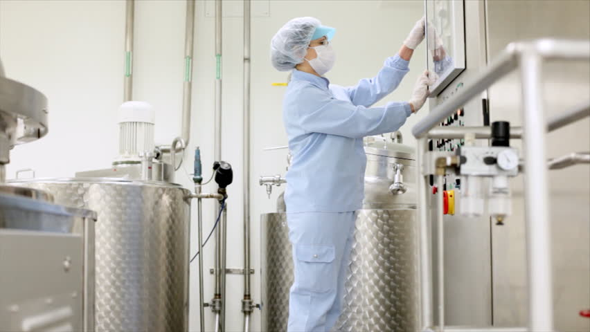 Preparing machine for work in pharmaceutical factory.