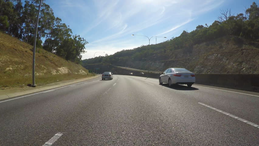 Vehicle POV, driving along freeway from Stirling, Adelaide Hills, to Adelaide, South Australia.