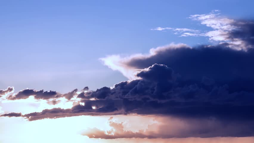 TIME LAPSE CLOUDS FAST MOVING AT EVENING TIME, SUNSET CLOUD MOTION. Aerial pan shot over clouds during beautiful sunset time-lapse, Time lapse sunrise,clouds on the sky, beautiful sunset, time-lapse.