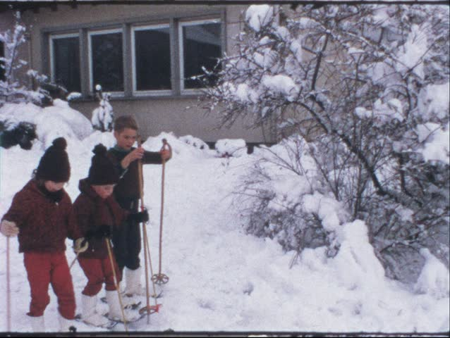 Vintage 8 mm film: Children on ski, 1970s | Shutterstock HD Video #3395021