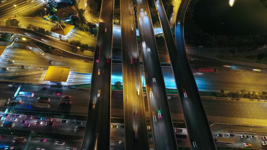 Time lapse, Hyperlapse, Of traffic on city streets at night. Aerial view and top view of traffic on freeway, 4K. | Shutterstock HD Video #33978301