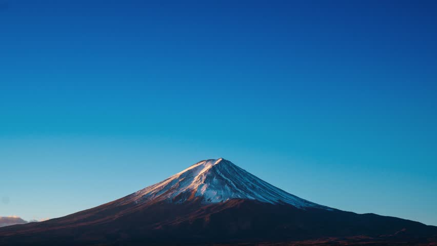 Mt. Fuji or Mount Fujisan or Fujiyama mountain in morning dawn in November. View from Fujikawaguchiko city, Yamanashi prefecture, Japan. (4K Time-lapse) | Shutterstock HD Video #33992011