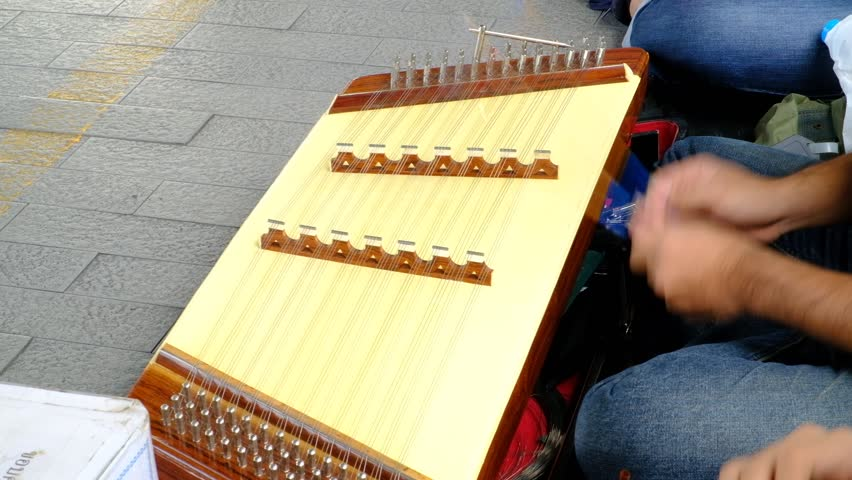 Thai instruments.man playing Thai wooden dulcimer musical instrument named as Khim at street market. | Shutterstock HD Video #33999451