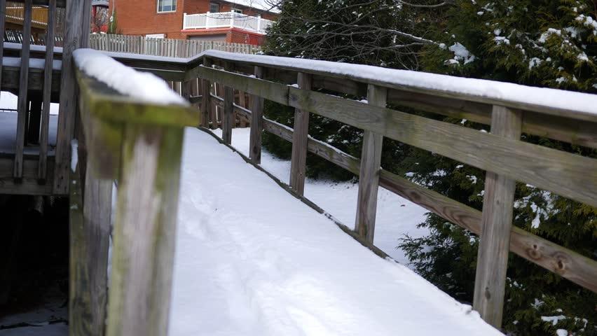 Snow covered handicap ramp in winter near rear of business  | Shutterstock HD Video #34002841