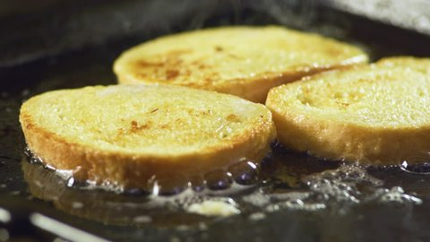 Preparing french toast for breakfast, on electric grill, close up