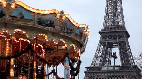 Eiffel Tower and Carousel (merry go round) in Paris, France, French Architecture