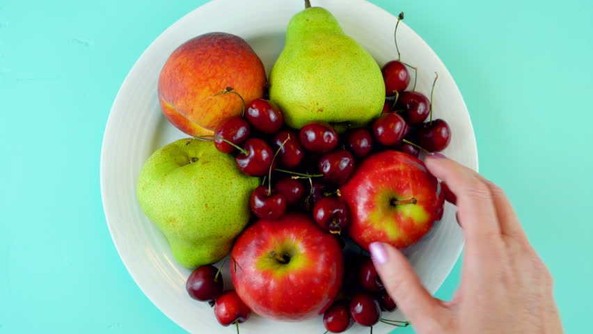 Healthy-eating New Year resolution for giving up sugary junk foods and replacing with healthy raw natural fruit.
