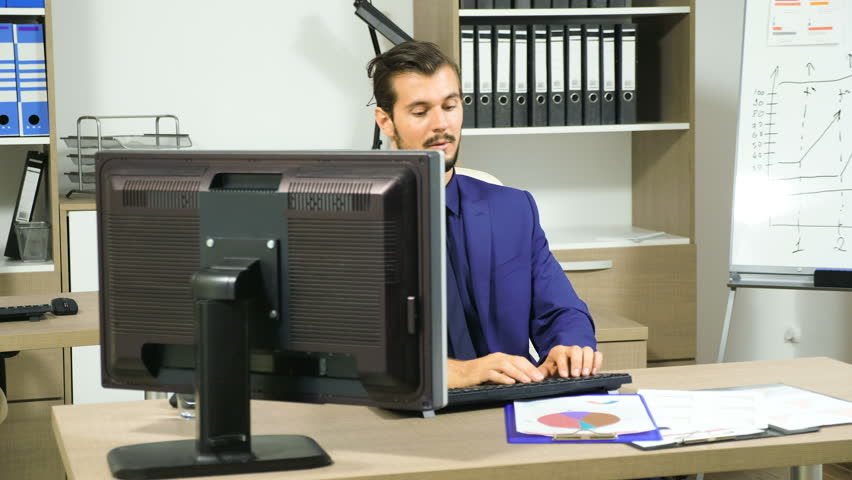 Stressed business person typing funny a reply to an email. Stress and work | Shutterstock HD Video #34245871