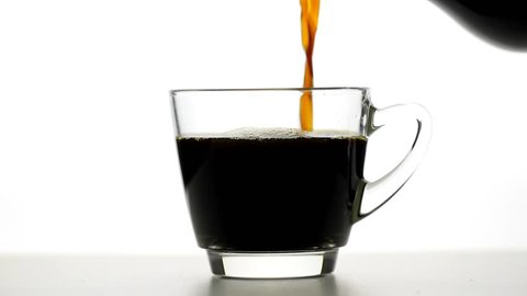 pouring coffee and coffee cup on white background