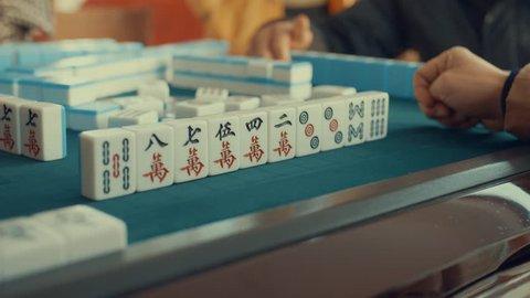 Chinese playing mahjong
