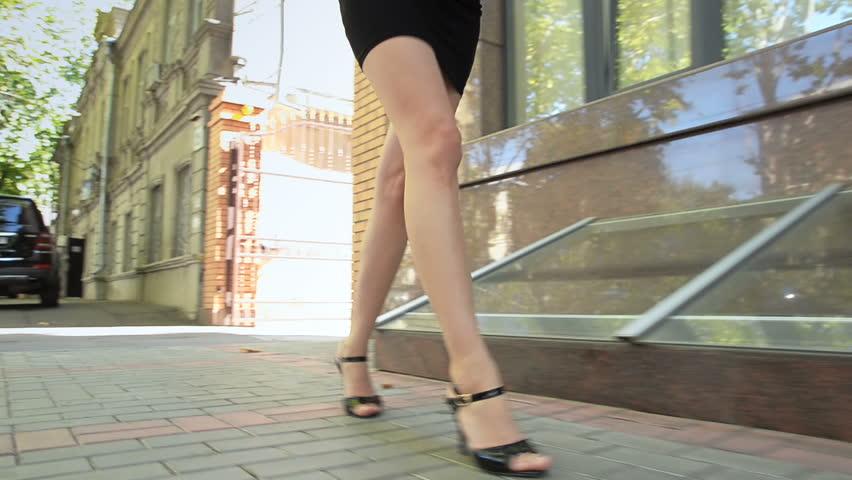 Business lady drinks street tea and walks down street #34269571