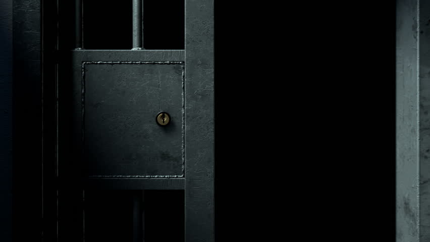 A static camera closeup of a heavy welded iron jail cell door sliding and slamming shut on a dark moody background