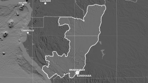 Zoom-in on Congo Brazzaville outlined on the globe. Capitals, administrative borders and graticule. Elevation & bathymetry - grayscale contrasted