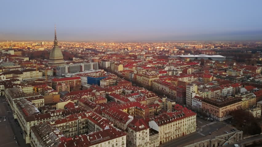 Turin skyline aerial view at sunrise pan over city center