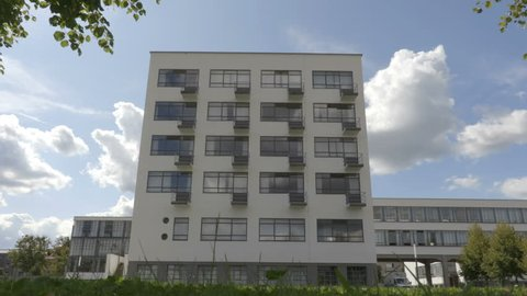 Dessau-Rosslau / Germany - 09.05.2017: Person moves in front the Bauhaus facade.