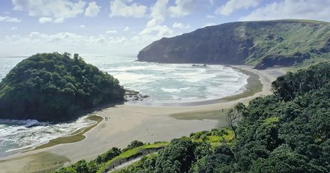 aerial over bethells beach ocean, auckland, New Zealand