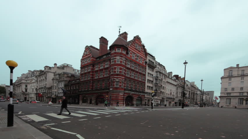 Blinking street lights at intersection near Prince Charles Castle in London