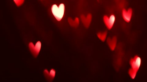 Valentine's Day Background. Holiday Blinking Abstract Valentine Background with Glowing Hearts. 4K UHD Video Footage. Heart Shape Bokeh. Love concept