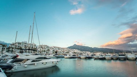 Day to night timelapse of Leisure port in Marbella at sunset. Beautiful landscape of the harbor of puerto banus in Malaga coast