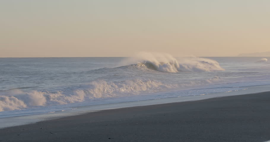 Stormy and furious waves of the ocean crashing on the shore in a windy day. Climate Change and Global Warming concept.