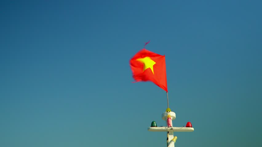 The red flag develops against the background of the blue sky. Vietnam.. | Shutterstock HD Video #34453003