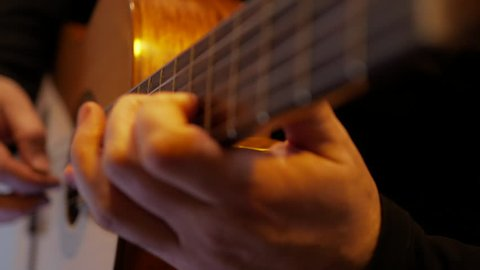 4k Guitarist plays bossa nova music by classic acoustic guitar at the stage during show close-up