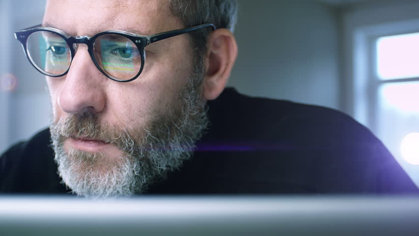 Close up of a businessman working concentrated with his computer - tracking shot