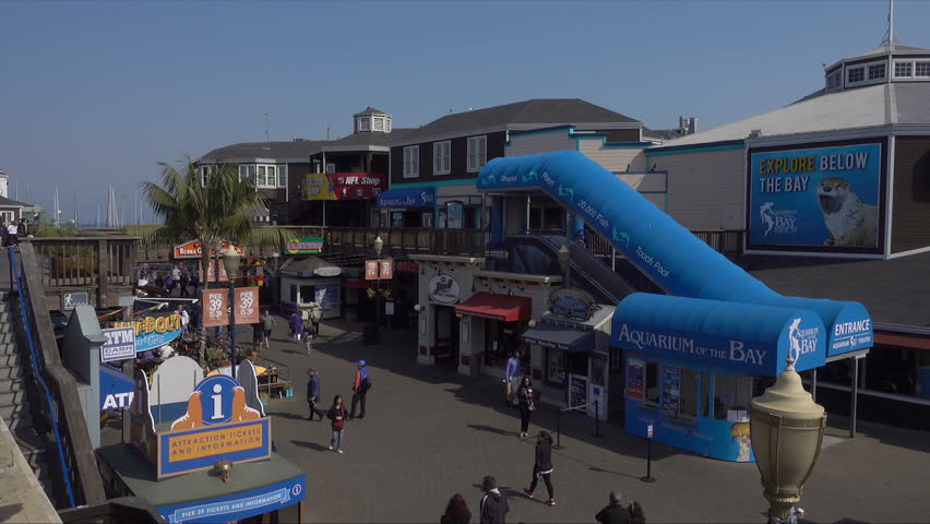SAN FRANCISCO, CALIFORNIA/USA - OCTOBER 18, 2017: Pier 39 attractions. Pier 39 is a shopping center and popular tourist attraction. | Shutterstock HD Video #34509721
