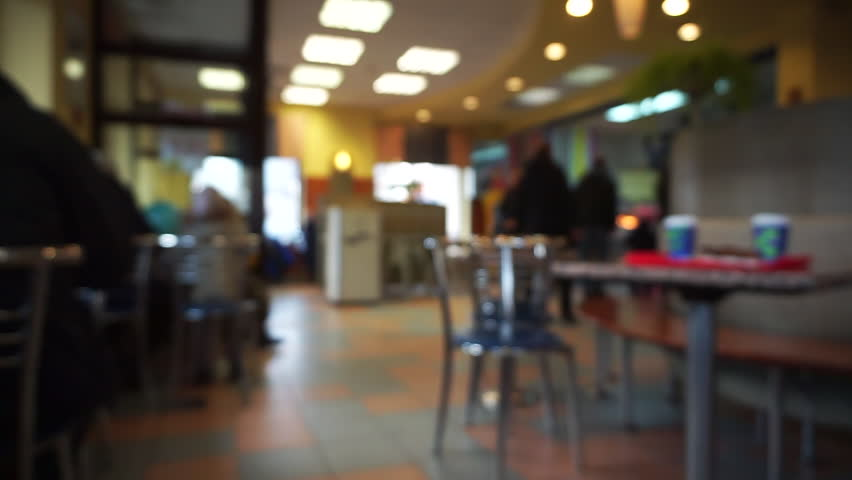 Defocused cafe or fast food or restaurant interior with people, blurred bokeh background