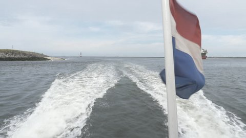Boat on the North Sea Rotterdam Maasvlakte with Dutch flag
