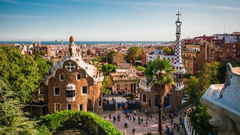 Barcelona, Spain, time lapse view of Park Guell and Barcelona cityscape at sunset.