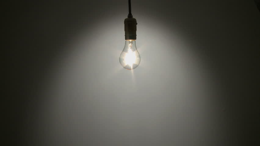 Light bulb fades up - HD stock footage clip