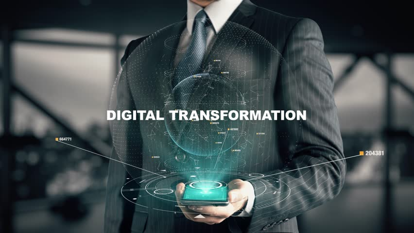 Businessman with Digital Transformation hologram concept