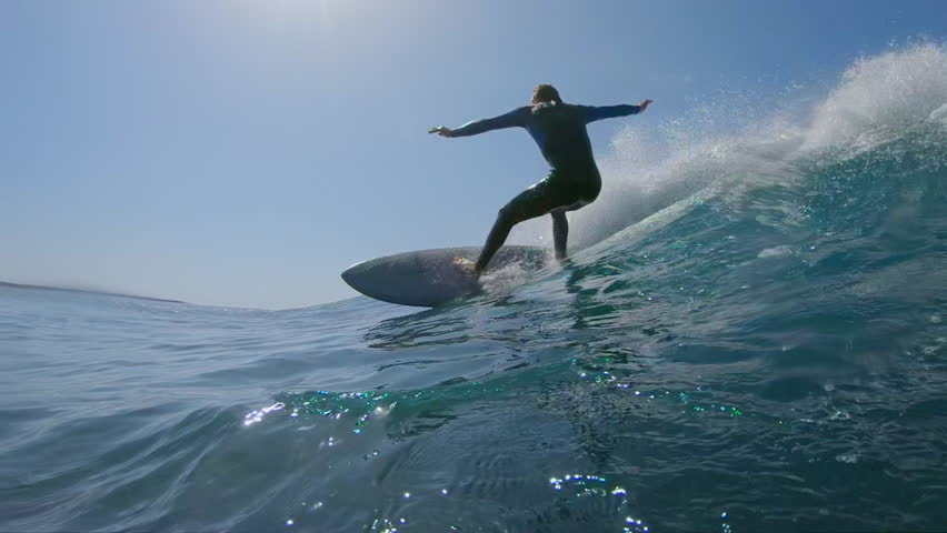 SLOW MOTION, LOW ANGLE, UNDERWATER: Surfer makes a turn on big blue ocean wave on hot sunny day in summer. Surfer carving awesome wave on his cool surfboard. Epic shot of male riding wave on surfboard | Shutterstock HD Video #34638991